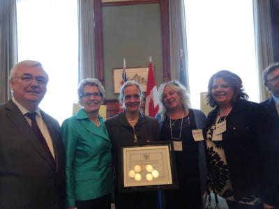 left to right:  John Gerretson (Min Attorney General), Kathleen Wynn (Premier of Ontario), Christine Peringer (Board Chair), Sheri Halladay (Program Coordinator) & Joellen McHard (Executive Director).