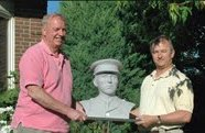 Dick Harington (left) and Ottawa sculptor Dave Watson with the commissioned bust of Canadian flying ace William Barker.