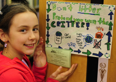 """""""Don't Litter, Pretend You Were the Critter!""""  is the message from Libby Hirst of Pakenham Public School, shown with her poster, one of the winning designs in MVFN's poster contest to raise awareness of the environmental problem with plastic bags.  Photo © John Fowler"""