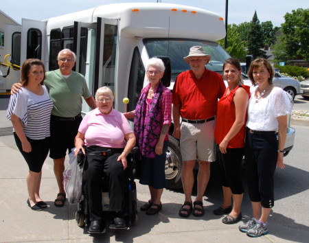 Generous donations from Jenepher Hooper and members of the community purchased a new bus to transport Fairview Manor (FVM) residents. Shown with the new bus are, from left: FVM Recreation Therapist (RT) and driver Kayla Nichols, driver trainer John Montgomery, FVM Residents' Council President Muriel Currie, top donor Jenepher Hooper, Almonte General Hospital-FVM Foundation Board Chair Al Lunney, RT and driver Ashley Charlebois and RT and driver Sheila Lefebvre. Missing from the photo are RT and driver Julie Rice and AGH-FVM Assistant Director of Care and Manager of Complex Continuing Care Mary-Ellen Harris.