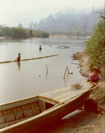 The boat was an interesting shape — very long, but not very wide. As a result, it was quite tippy. As you can see, the river is not only the main road for travel, but also a popular playground for kids.