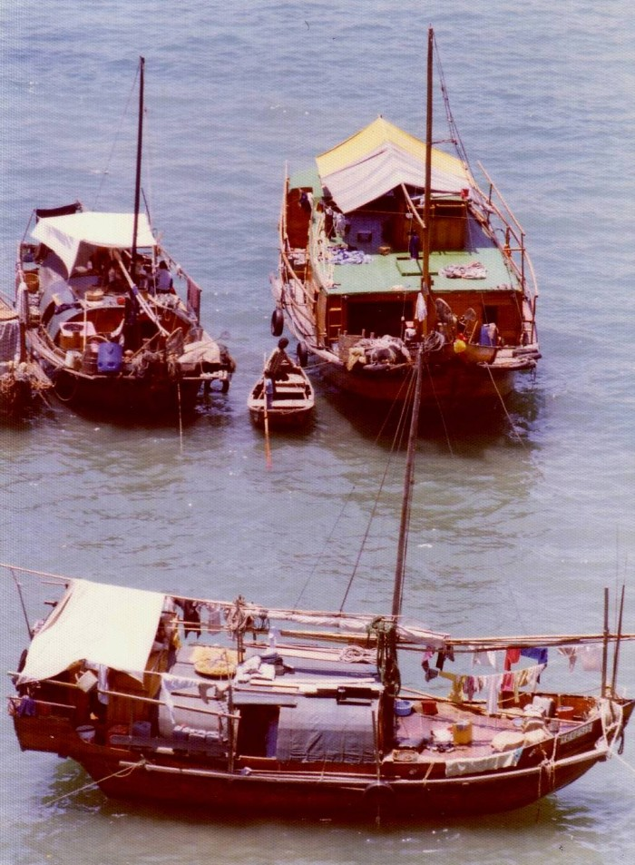 A nice shot showing three fishing boats. These boat not only provide the livelihoods of the fishing families, but are also their homes.