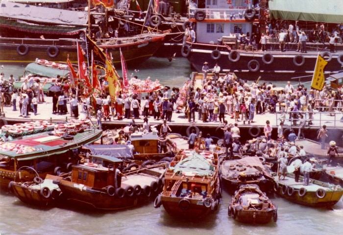 The docks are crowded, a riot of colour.