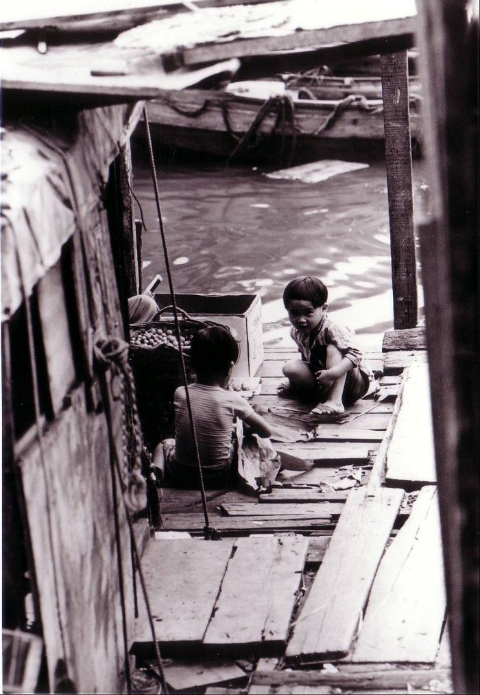 Children playing on their family boat.