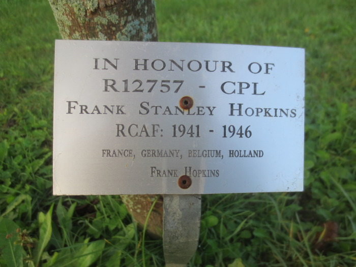 By the base of each of the 105 maple trees on the grounds of the Veterans' Memorial Walkway is a plaque in honour of a veteran from our community.