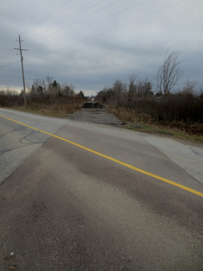 As far as the eye could see, the once essential rail corridor ran uninterrupted through our rural and urban neighbourhoods. Now, where highways, concession roads, and municipal streets cross the abandoned CP railbed, obstructions are in place.